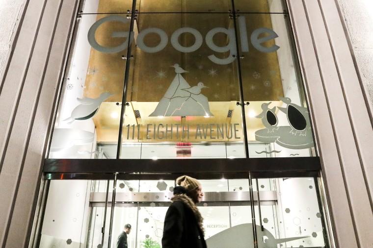 Image: A pedestrian walks past Google headquarters in New York City