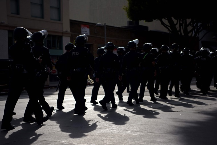 Image: police riot gear march line