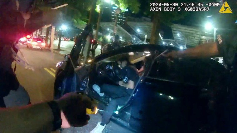 Image: Still frame from Atlanta Police Department bodycam video footage of police officer Ivory Streeter, shows car driver Messiah Young being shot by a taser, during ongoing protests against the death in Minneapolis police custody of George Floyd, in Atl
