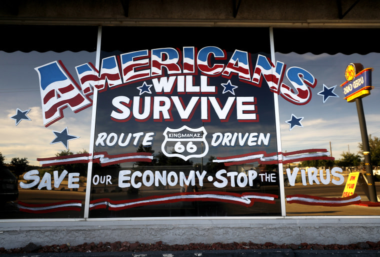 Image: An automobile sign sends a positive message in the fight against coronavirus in Kingman, Ariz., on May 24, 2020.