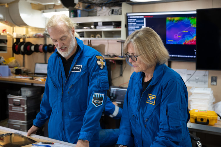 Dr. Kathy Sullivan and Victor Vescovo reviewing the plans before their dive to Challenger Deep.