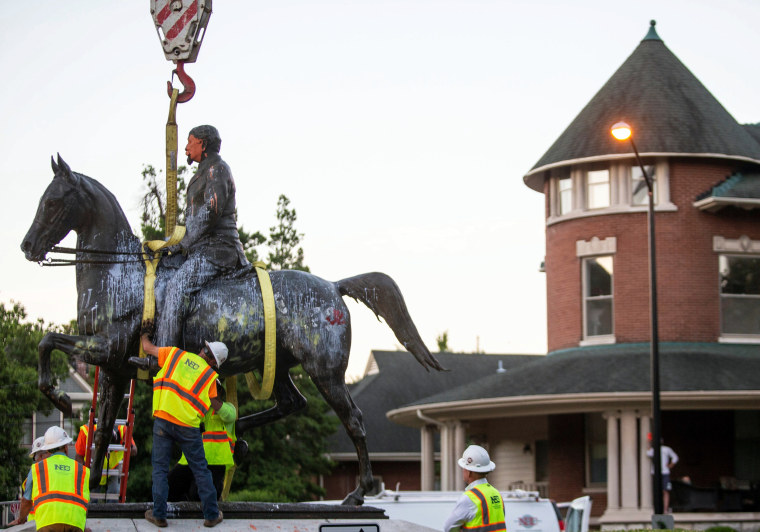 Image: The John B. Castleman statue is prepared for its removal from the pedestal in Louisville