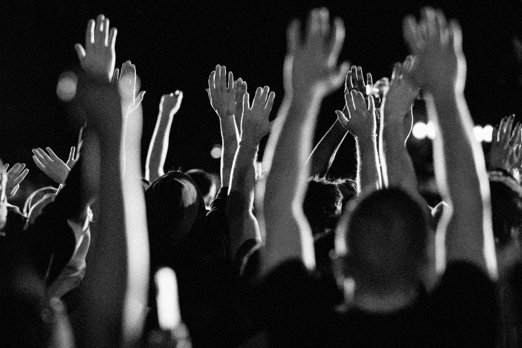 Image: Demonstrators raise their hands at a protest outside of the White House on May 31, 2020.