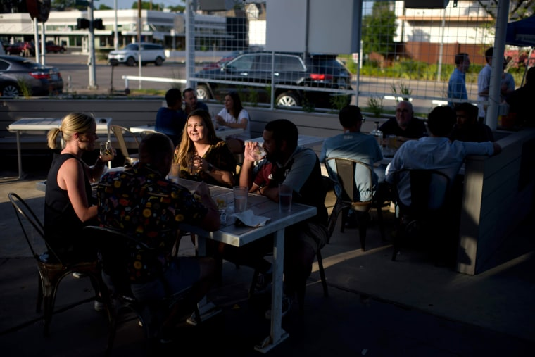 Image: People get together for drinks at Eight Row Flint in Houston, Texas, on May 22, 2020.