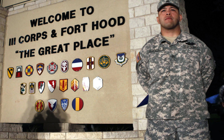 Image: Sgt. First Class Rodriguez stands guard before a news conference at Fort Hood Army Post in Texas