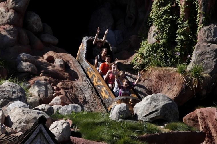 Image: Guests ride Splash Mountain at Disneyland in Anaheim, Calif., in 2013.