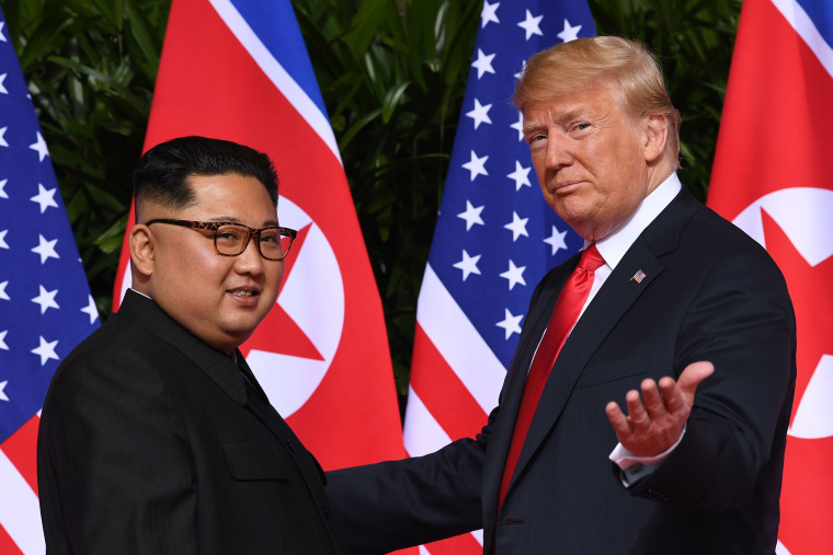 Image: President Donald Trump gestures as he meets with North Korea's leader Kim Jong Un at the start of their historic U.S.-North Korea summit at the Capella Hotel on Sentosa island in Singapore