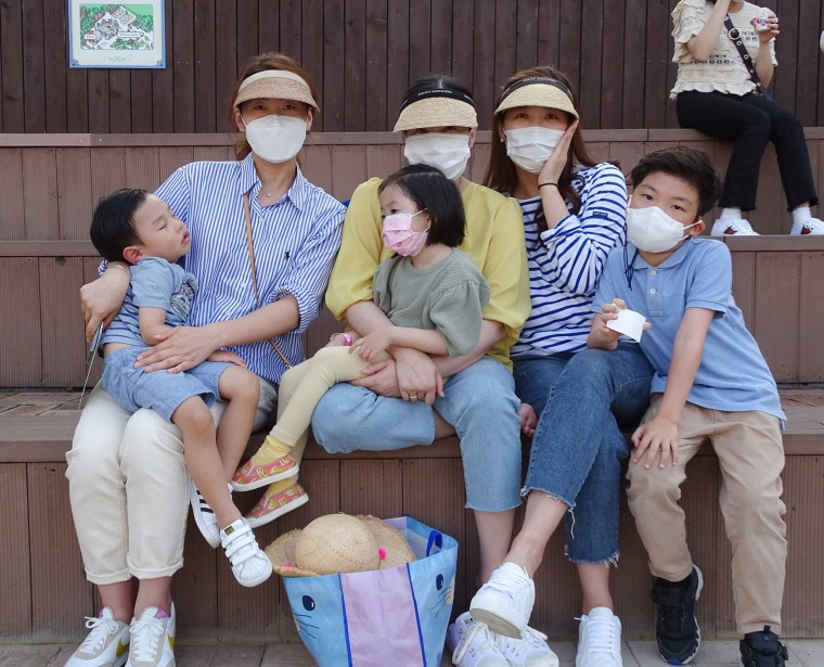 Image: Choi Woo-Jung (right) with her friends and their children at Everland amusement park in South Korea.