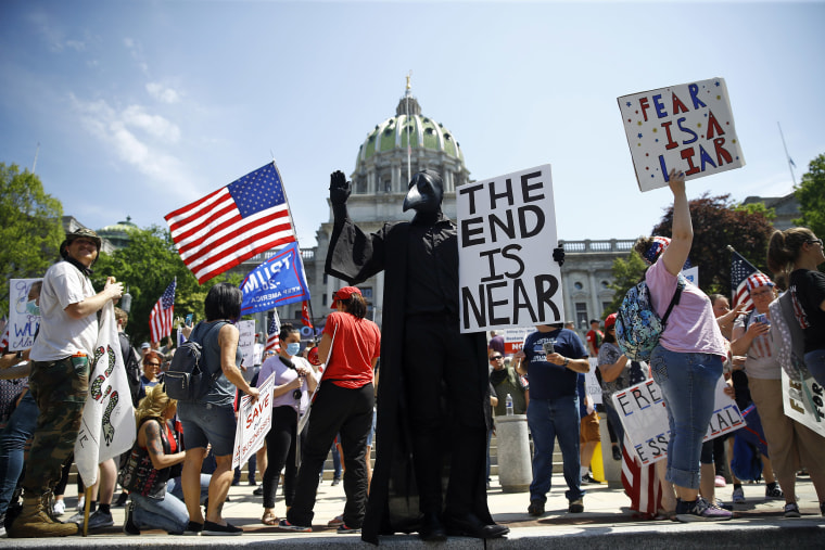 Image: Protesters demonstrate during a rally against Pennsylvania's coronavirus stay-at-home order at the state Capitol in Harrisburg, Pa