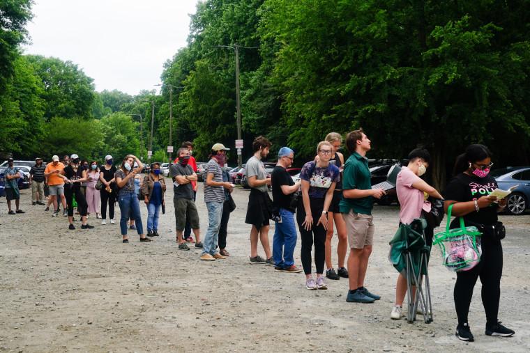 Voters wait in line on June 9, 2020 in Atlanta.