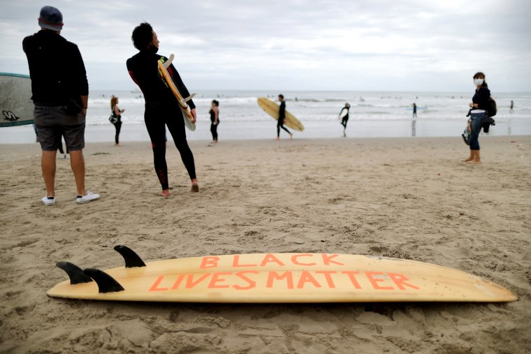 Image: Black Girls Surf paddle out