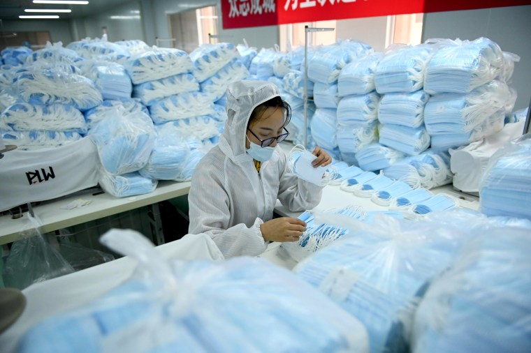 Image: An employee makes face masks on a factory production line in Shenyang, China, on May 16, 2020.