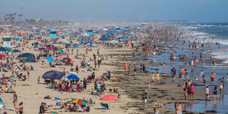 People at the beach in Huntington Beach, Calif., on Sunday, June 14, 2020, amid the coronavirus pandemic.