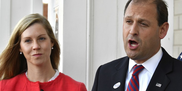 Rep. Andy Barr and his wife, who went by Carol, speak with reporters outside his polling place in Lexington on Nov. 6, 2018.