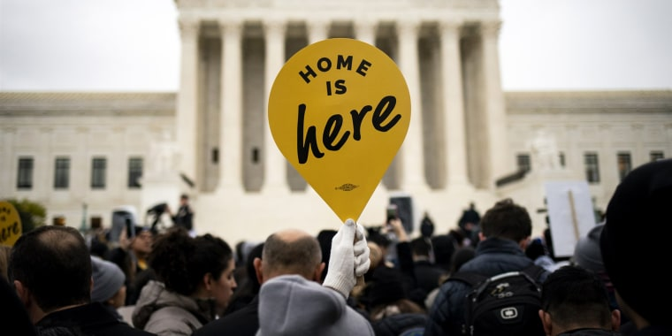 A demonstrator holds a sign in support of the Deferred Action for Childhood Arrivals program outside the Supreme Court in November 2019.