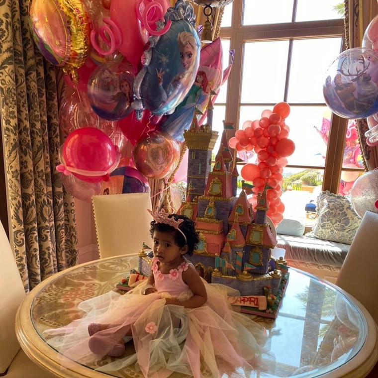 Capri Bryant sits in front of her Disney castle cake on her first birthday.