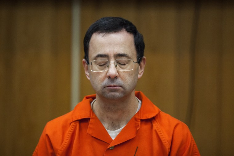Image: Larry Nassar listens during his sentencing at Eaton County Circuit Court in Charlotte,