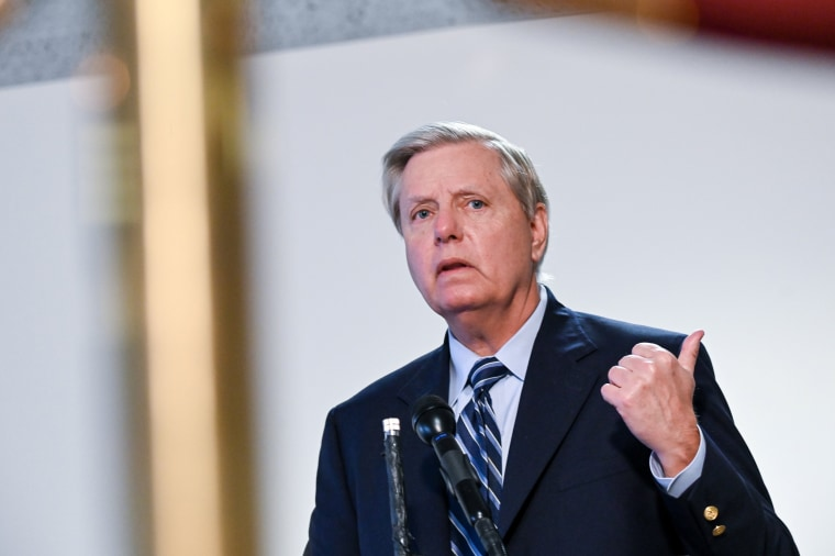 Image: Lindsey Graham speaks to reporters after a luncheon on Capitol Hill in Washington