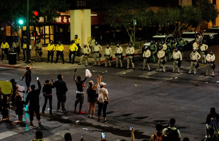 Officers line up in front of demonstrators on June 1, 2020, in downtown Las Vegas.