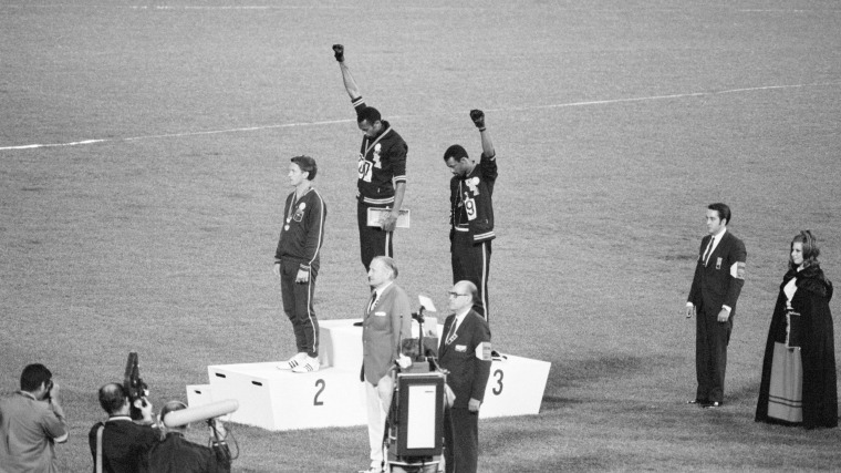 Image: Tommie Smith and John Carlos, gold and bronze medalists in the 200-meter run at the 1968 Olympic Games, engage in a victory stand protest against unfair treatment of blacks in the U.S.