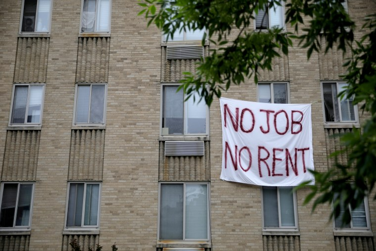 Image: A sign protesting rent hangs from an apartment building in Washington on May 18, 2020.