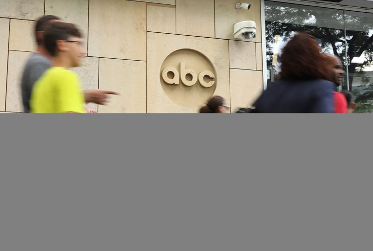 Pedestrians pass ABC headquarters in New York.