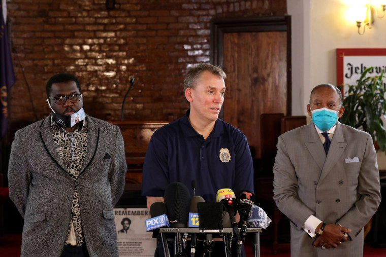 Image: NYPD Commissioner Shea stands with Reverend McCall and First Deputy Police Commissioner Tucker at a news conference in Brooklyn