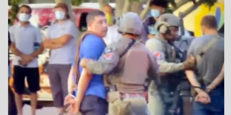 Image: Alleged gunman in blue shirt arrested