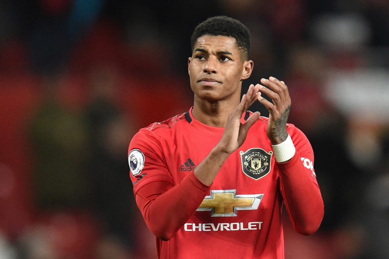 Image: Manchester United's English striker Marcus Rashford applauds supporters on the pitch after the English Premier League football match between Manchester United and Aston Villa at Old Trafford in Manchester.