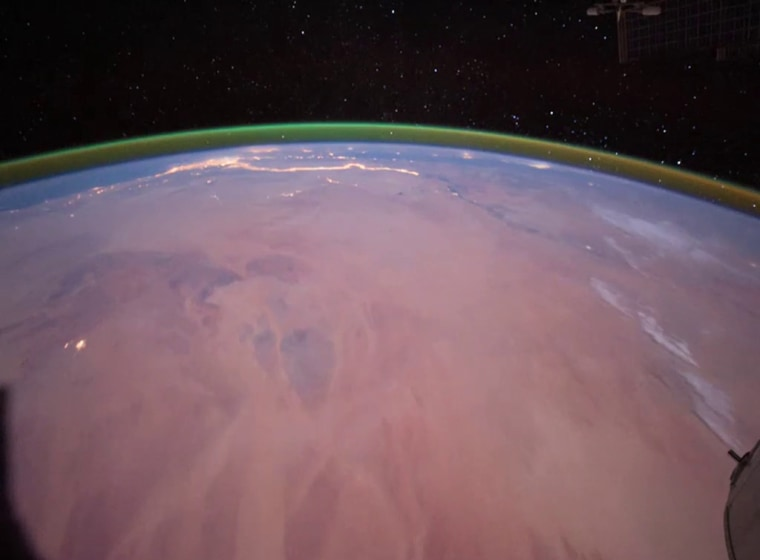 Mars' atmosphere has a distinct green glow that astronomers say is caused by interactions between sunlight and oxygen.