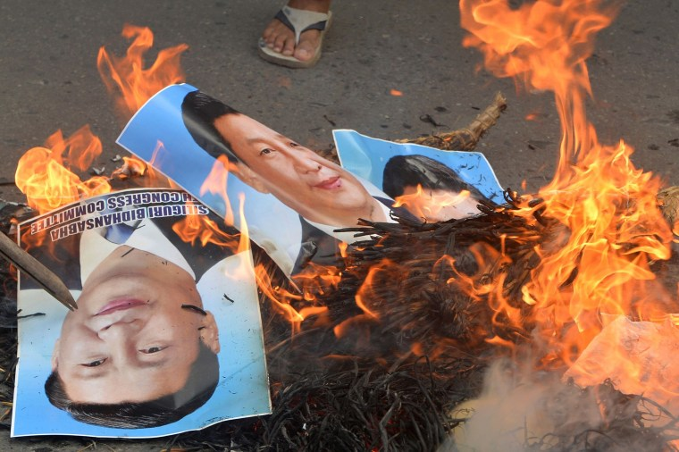 Image: Burning posters of Chinese President Xi Jinping