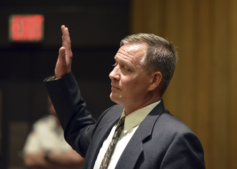 Springfield, Mass., police officer Gregg Bigda is sworn in before testifying in a gun case in Hampden Superior Court on May 24, 2017.