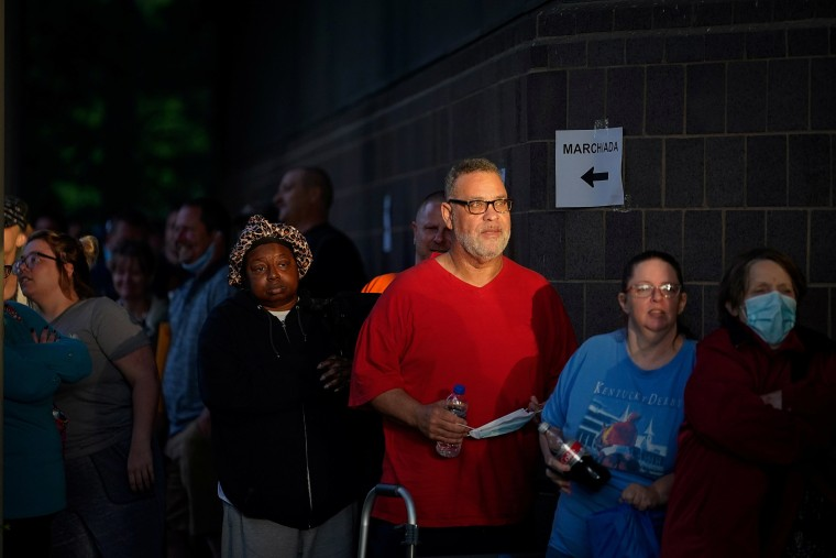 Image: Hundreds of people line up outside the Kentucky Career Center, over two hours prior to its opening, to find assistance with their unemployment claims in Frankfort, Kentucky