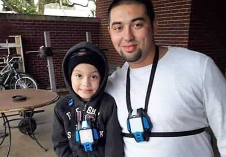 Nicolas Chavez with his son.