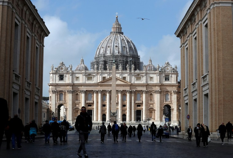 Image: People walk on St. Peter's Square after the Vatican reports its first case of coronavirus