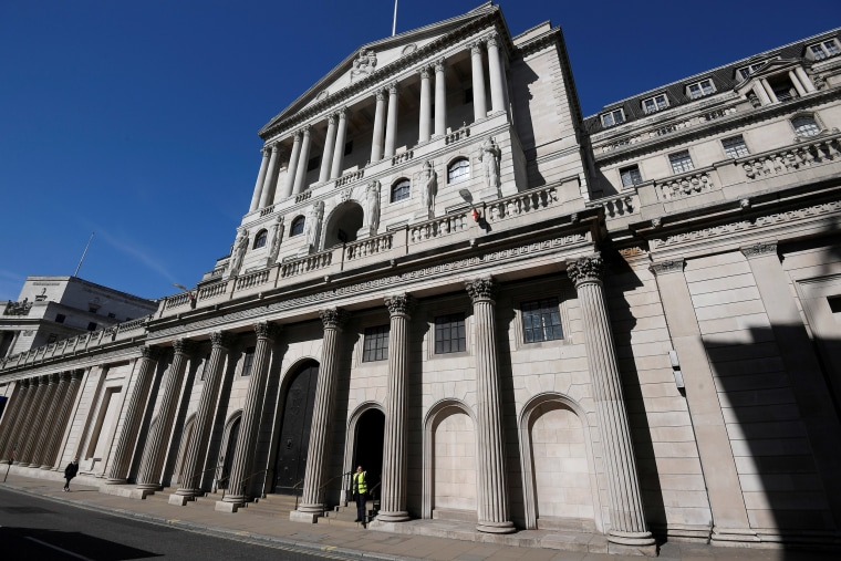 Image: A security officer stands outside the Bank of England in London, Britain
