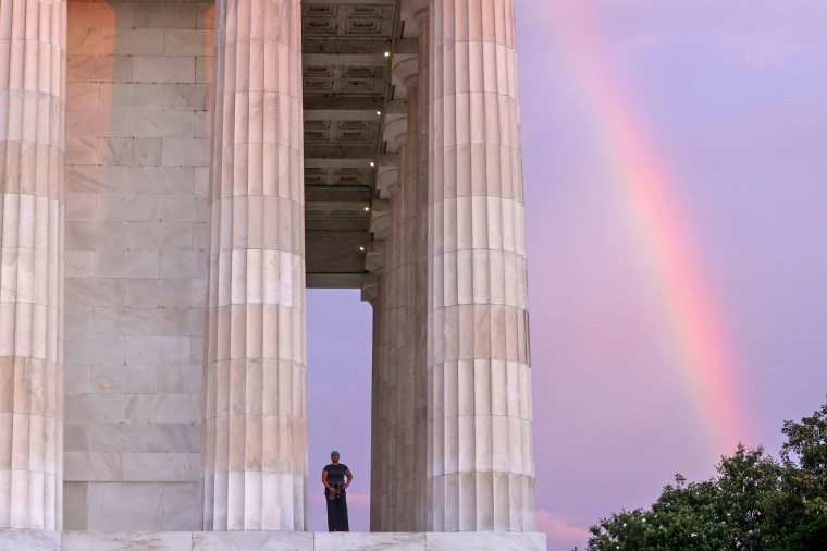 Image: A rainbow appears behind the Lincoln Memorial as Fitzpatrick prepares to begin her day, coincidentally Juneteenth, with a sunrise walk in Washington