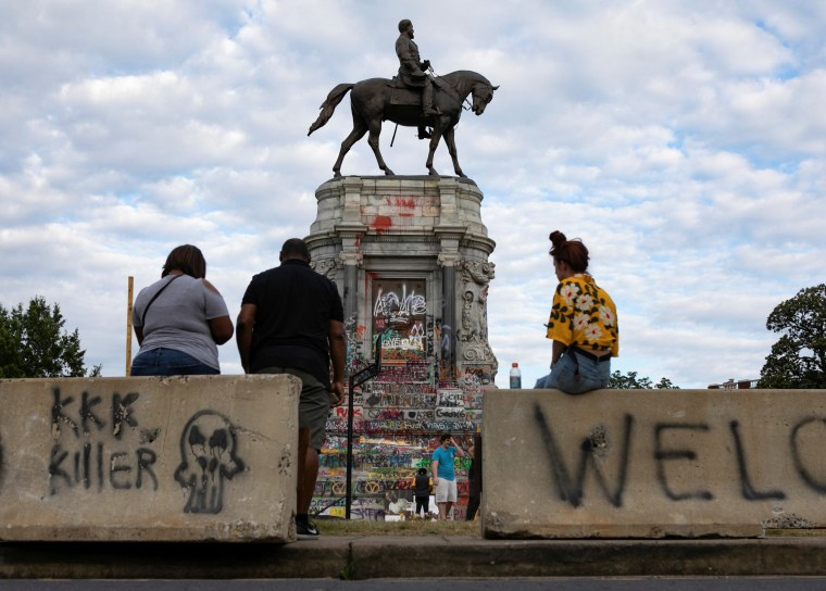 Image: People congregate around the base of the monument to Confederate General Robert E. Lee in Richmond