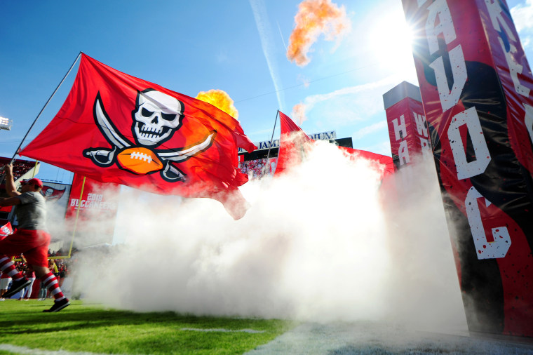 Image: The Tampa Bay Buccaneers flag flies through the team field entrance before a game in Tampa, Fla., in 2018.