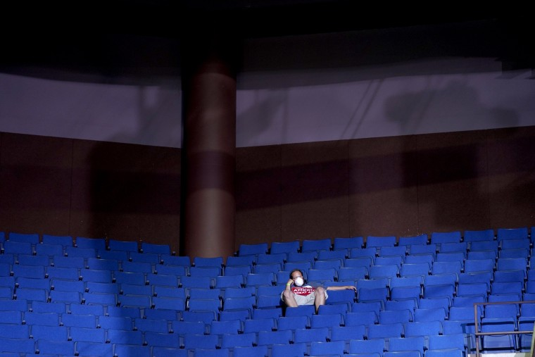 Image: A supporter sits in the stands at a campaign rally for President Donald Trump in Tulsa, Okla., on June 20, 2020.