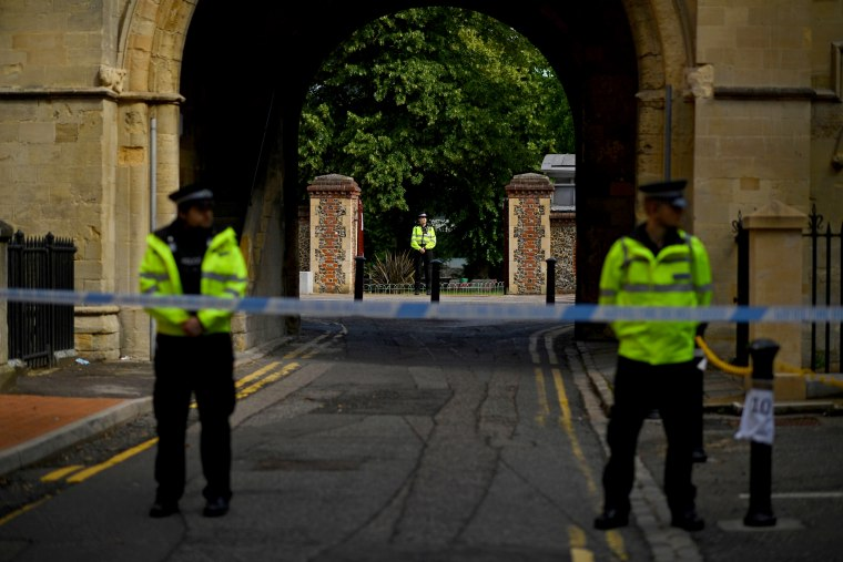 Image: Police officers secure the scene near Forbury Gardens Park after a stabbing attack that left three people dead in Reading, England, on June 20, 2020.