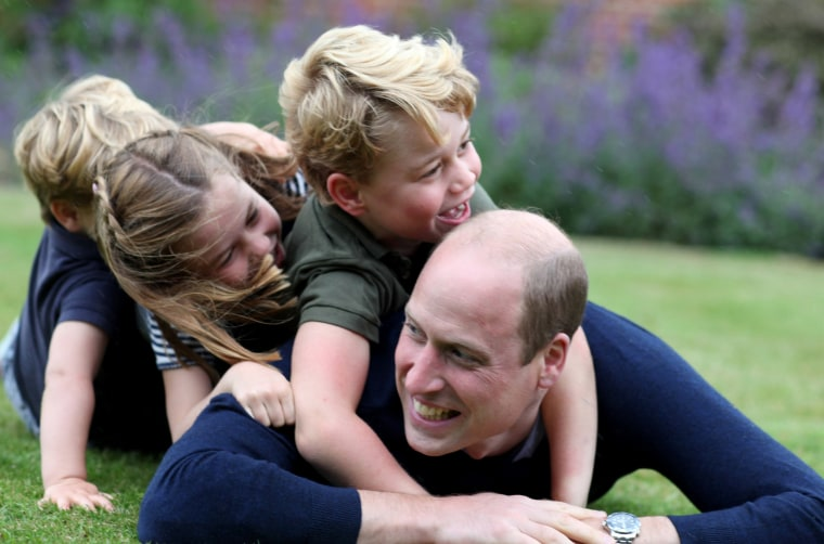 Image: Prince William plays with Prince George, Princess Charlotte and Prince Louis in Norfolk in June 2020.