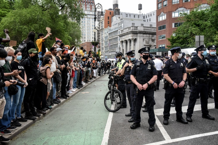 Image: Protesters gather near police during a rally against the death of George Floyd in New York on May 28, 2020.