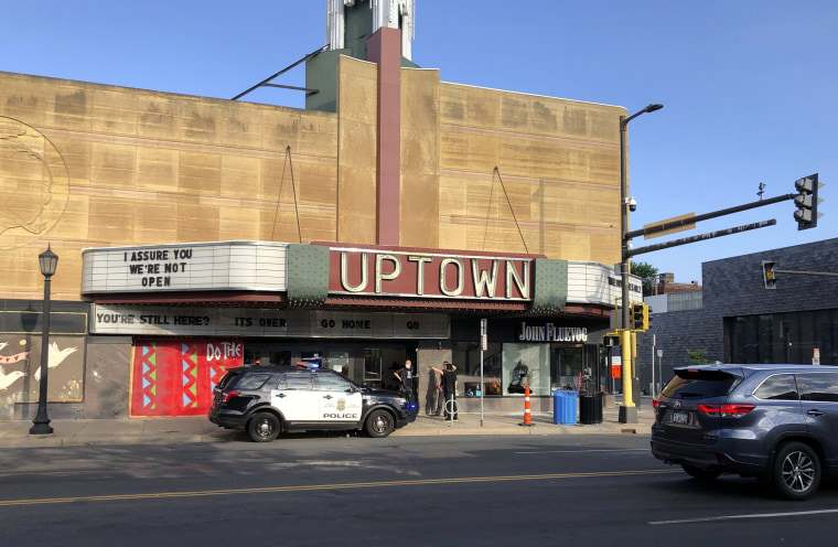 Image: A police vehicle outside the Uptown Theatre where multiple people were shot, one fatally, in Minneapolis on June 21, 2020.
