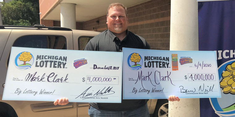 Mark Clark of South Rockwood, Michigan shows off his two wins for a $4 million instant game.