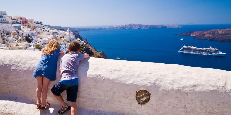 Two children enjoying view from Fira, Santorini