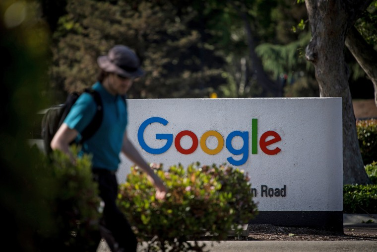 A pedestrian walks past signage at Google headquarters in Mountain View, California, in 2018.