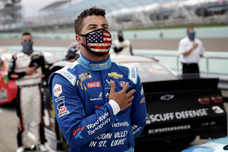 Image: Bubba Wallace stands for the national anthem before a race at Homestead-Miami Speedway in Florida on June 14, 2020.