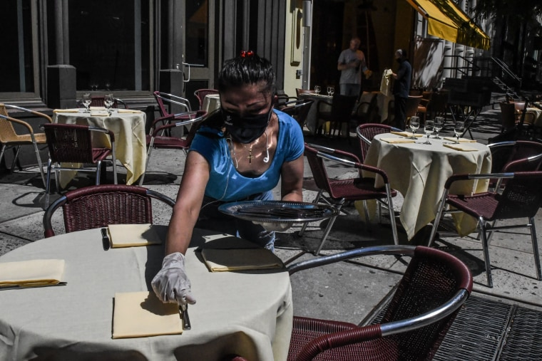Image: An employee sets a table outside of the Cipriani restaurant in New York as the city begins phase 2 of its reopening on June 22, 2020.