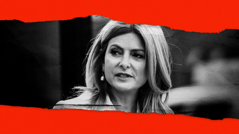 Image: Lawyer Lisa Bloom in between tears of red paper.